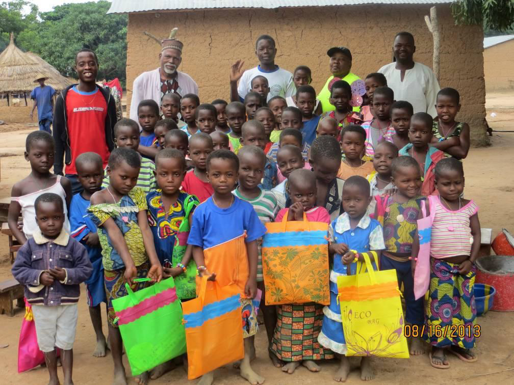 Children receiving their bag of goodies on the last day