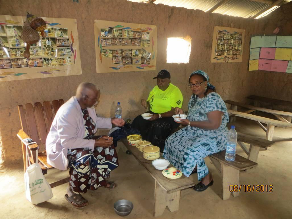 Eating the lunch of igname pilée and sauce between the VBS activities and the literacy class Former President of Fulani Association, Pastor Lemou attended the activities.