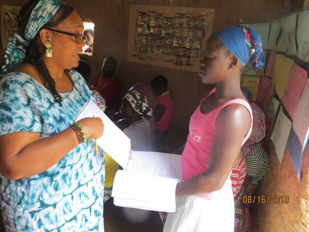 """Teaching English in the village, Kotossou, the classes were attended by older teens and adults. We used the """"Everyday English"""" curriculum from Literacy and Evangelism International."""
